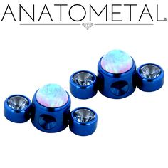 Captive Gem Clusters in ASTM F-136 titanium, anodized dark blue with synthetic Aquamarine and synthetic Opal #6 gems
