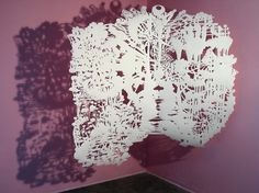 Lily Swell Machine | one piece of cut paper suspended by wire in front of pink painted walls with cast shadows | 2003 | artist Chris Natrop