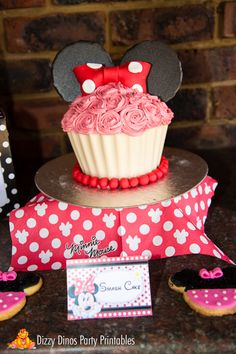 Smash cake at a Minnie Mouse Birthday Party!  See more party ideas at CatchMyParty.com!