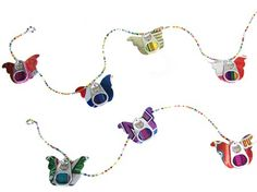 Recycled Can Tab & Angel Garland - handmade in Guatemala from recycled aluminum can tabs and soda cans strung together with colorful glass beads.