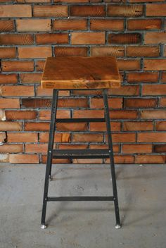 Ignoring the stool for a second; Is that a faux brick wall where the 'bricks' are mortared 2x6s? Love!!