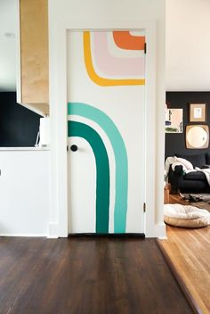 rainbow door mural inspired by Ari of @quirkt_n_thrifted and the most beautiful pop of color