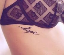Hope tattoo on rib cage