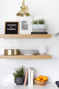 kitchen shelves with herbs. Kitchen decorating 101. Tips and tricks to decorate your kitchen. Plus, the dos and don'ts of this room. #kitchen #kitchendecor #decorating #styling #openshelving