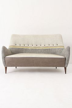 multiple fabrics loveseat with single row of buttons curved arms and curved backrest