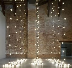 perfect hanging lights backdrop for a loft wedding!