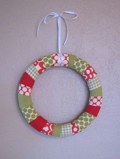 Christmas fabric wreath with flower or rosette embellishments