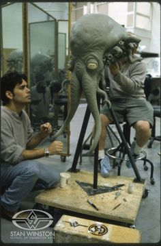Special effects character creators and master creature sculptors Christopher Swift and Shane Mahan sculpt a tentacled GALAXY QUEST Thermian head at Stan Winston Studio.