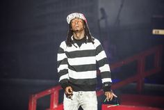 Sometimes you just have to close your eyes and feel the music. Just ask Lil Wayne, who embraces the moment during a performance on Oct. 16 in Paris