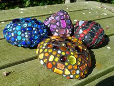 Yet more of my garden stones have been covered with left over bits of fused glass from the kiln.