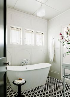 Cement tile for the bathroom. Love the pattern!