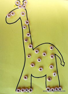Letter G = Giraffes. We decorated our giraffes with cheerios!