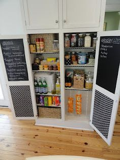 Organised pantry - I like the chalk board inside the doors for grocery lists and meal plans