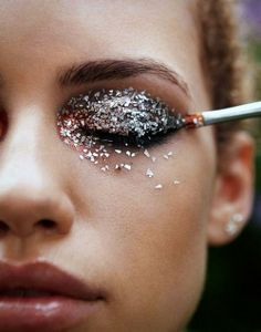 While this wild glitter eye makeup may only be fit for the runway, it sure is fun to admire! #beauty #makeup #sparkle #eyes