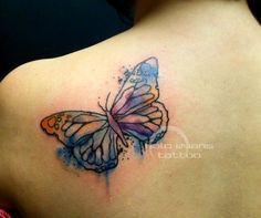 Watercolor butterfly tattoo by Halo Evans at Lasting Impressions in Ames, IA