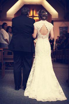 The back of this dress is amazing! // Photo by Tom #weddingphotographersminnesota #weddingphotography