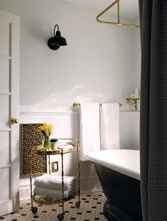 pale blue bathroom with brass fixtures
