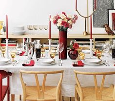For easy ooh factor, use a white tablecloth, white dishes, and just one or two rich accent colors (say, cranberry and amber). Flowers and centerpieces should be tall enough to talk under or short enough to talk over.
