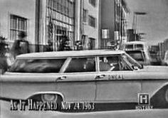 11/24/63 - An ambulance carrying Lee Harvey Oswald emerges from the basement of the Dallas Jail.