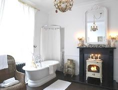 Modern Victorian Bathroom. ♥ the white log burner.