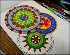 I just starting using my markers more and bought some gelly roll pens because I love the vibrancy and the detail. I am always inspired by Draw Doodle Decorate's mandala work.    Draw Doodle and Decorate: Mandela Mania