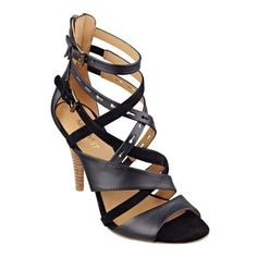 """Let's see. How do we describe our Luigi caged open-toe gladiator sandals? Sexy, strappy, intoxicating, mesmerizing? How about all of the above? Back-zip for easy on/off. Padded footbed for all-day comfort. Leather upper. Man-made lining and sole. Imported. 4"""" stacked high heels."""