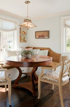 Breakfast room with lovely round table and neat lighting. What a way to wake up!