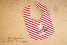 Boys First Birthday Bib - Sock Monkey theme in red, blue, and brown  - Personalized bib. $18.00, via Etsy.