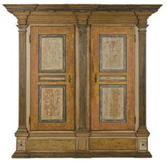 Sold $85,000 Lancaster County, Pennsylvania painted hard pine schrank, ca. 1780, the architectural molded cornice over raised panel doors with fluted quarter columns, resting on a molded base with faux drawers and an overall scrubbed sponge decorated surface, 88 1/2'' h., 76'' w.
