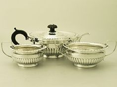 A fine and impressive antique Victorian English sterling silver three piece tea service/set in the Queen Anne style; an addition to our silver teaware collection. SKU: W8962 Price: GBP £1,395.00 http://www.acsilver.co.uk/shop/pc/Sterling-Silver-Three-Piece-Tea-Service-Queen-Anne-Style-Antique-Victorian-67p6407.htm#.U_S93M90zcs