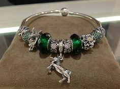 PANDORA Bangle Showcasing Green Faceted Murano,  Unicorn Dangle,  Green Pave.