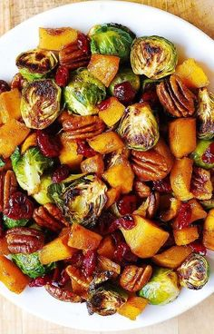 Thanksgiving Side Dish: Roasted Brussels Sprouts; Butternut Squash glazed with Cinnamon & Maple Syrup; Pecans & Cranberries. YUM! Healthy, vegetarian, gluten free Holiday Recipe. #Thanksgiving #Christmas #side #sidedish #holidays #holidaysidedish #glutenfree #gf