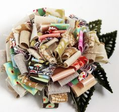 fabric scrap flower by Rebecca Sower (flickr) http://www.flickr.com/photos/rebeccasower/sets/72157623945715474/with/4884535341/ #flowers #handmade #crafts #fabric_scraps