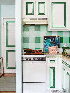 The kitchen corner, done in white and green to blend in, gets a helping of charm with grosgrain ribbon trim and a painted plaid backsplash.