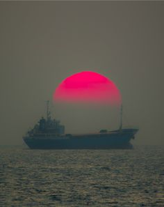 """Freighter """"transporting"""" the sun...""""Red sky at night, sailors' delight."""""""