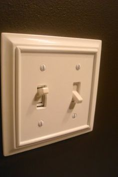 add molding around light switchplates to add character - Oh, and to cover up some mistakes a contractor made!