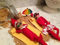 The funniest 'Elf on the Shelf' ideas....How cute is this one!!!!