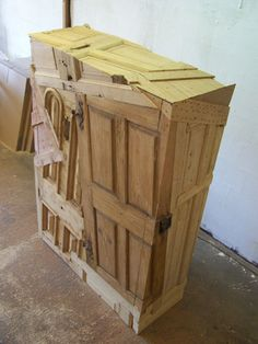 Beautiful armoire(?) made from recycled and reclaimed doors/wood-work, by Chris Ruhe