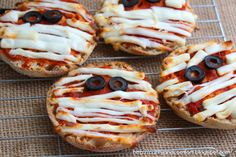 Kid-friendly mini mummy pizzas! A quick, fun snack to make before trick or treating. #recipe