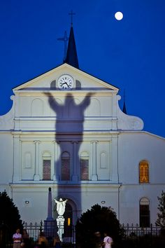Jesus' shadow on the back of St. Louis Cathedral