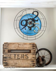 Junk styled clock from an antique fan grill and enamel bowl / part of A junk styled file sorter, quirky clock, and cool twine station for @paintedfox1 via FunkyJunkInteriors.net