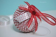 make a simple Christmas ornament by wrapping braided trim around a styrofoam ball.
