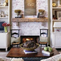 This is exactly my fireplace in my current home that we built 10 yrs ago, beam, brick and paint...except for the two wooden supports...like that idea and might add them