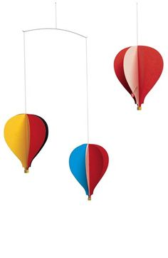 Love this whimsical balloon mobile in an array of bright and bold colors. #BRITAXStyle