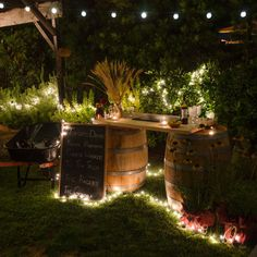 Sting outdoor lights around the #DIY bar you've made for the perfect lighting once the sun goes down. backyard beer garden, outdoor string lights diy, diy outdoor party lights, diy backyard bars, outdoor light, diy garden party lighting, backyard party lighting, string lights backyard, backyard string lights