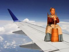there's a colonial woman on the left wing churning butter