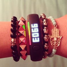 Nike fan Brittany gets to green with her fierce and elegant #armparty. #fuelband #nike