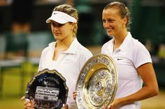 Petra Kvitova of Czech Republic poses with the Venus Rosewater Dish trophy next to Eugenie Bouchard of Canada and her runner-up trophy after their Ladies' Singles final match on day twelve of the Wimbledon Lawn Tennis Championships at the All England Lawn Tennis and Croquet Club on July 5, 2014 in London, England. (Photo by Al Bello/Getty Images)