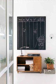 Mid century furniture and handmade chalkboard wall organizer.