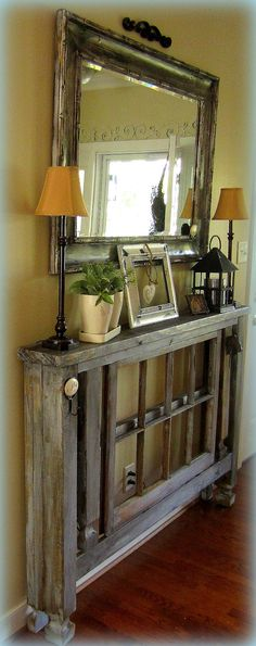 Entry way decor - No room in your hall way or entry?  Wow... this solves it.  My mind is going a mile a minute.  Thinking of a folding table, maybe wheels... can be rolled out to a table if / when needed!